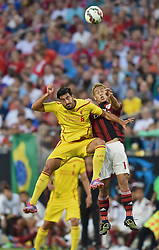 CHARLOTTE, USA - Saturday, August 2, 2014: Liverpool's Emre Can in action against AC Milan's Keisuke Honda during the International Champions Cup Group B match at the Bank of America Stadium on day thirteen of the club's USA Tour. (Pic by David Rawcliffe/Propaganda)