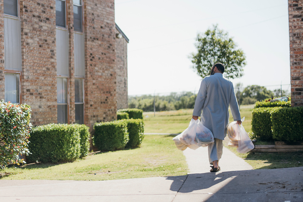 Gulab carries groceries to his home in Fort Worth, Texas on May 6, 2016.