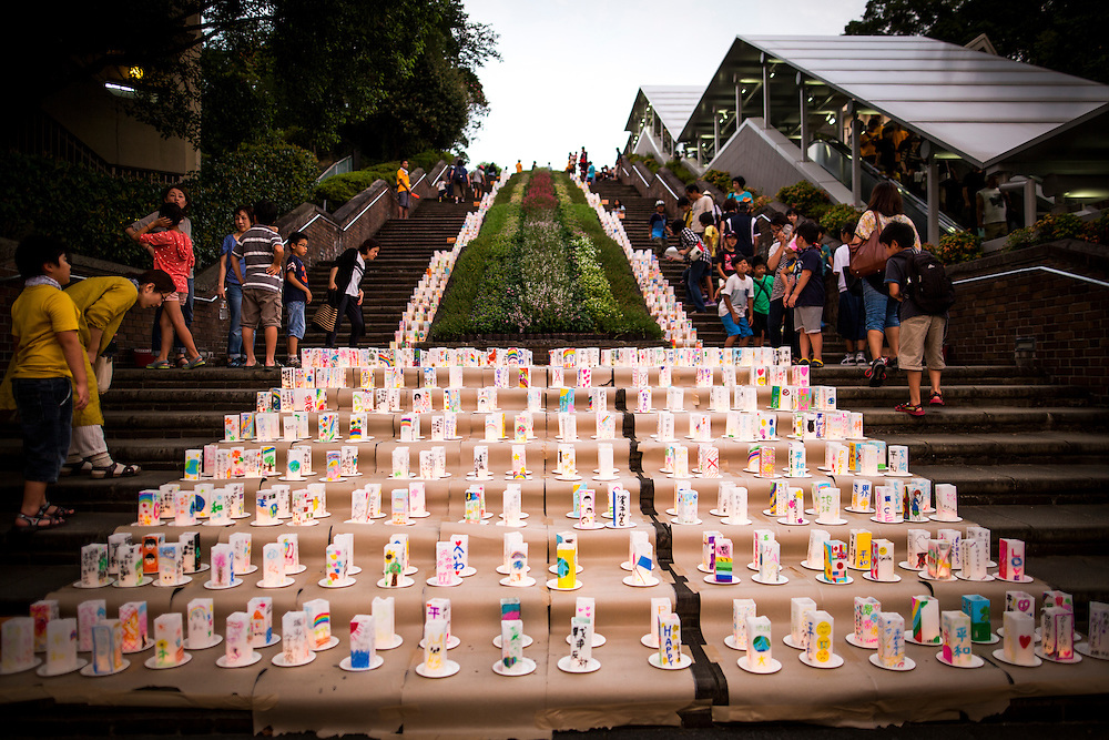 NAGASAKI, JAPAN - AUGUST 8 : Candle-lit paper lanterns with written message is seen at Nagasaki Peace Park on the eve ahead of the 71st anniversary activities, commemorating the atomic bombing of Nagasaki on August 8, 2016 in Nagasaki, southern Japan. On August 9, 1945, during World War II, the United States dropped the second Atomic bomb, a plutonium implosion-type bomb on Nagasaki city, killing an estimated 40,000 people which ended the World War II. (Photo by Richard Atrero de Guzman/NURPhoto)
