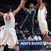 Keith Appling, Michigan, drives to the basket during the Virginia Cavaliers Vs Michigan State Spartans basketball game during the 2014 NCAA Division 1 Men's Basketball Championship, East Regional at Madison Square Garden, New York, USA. 28th March 2014. Photo Tim Clayton