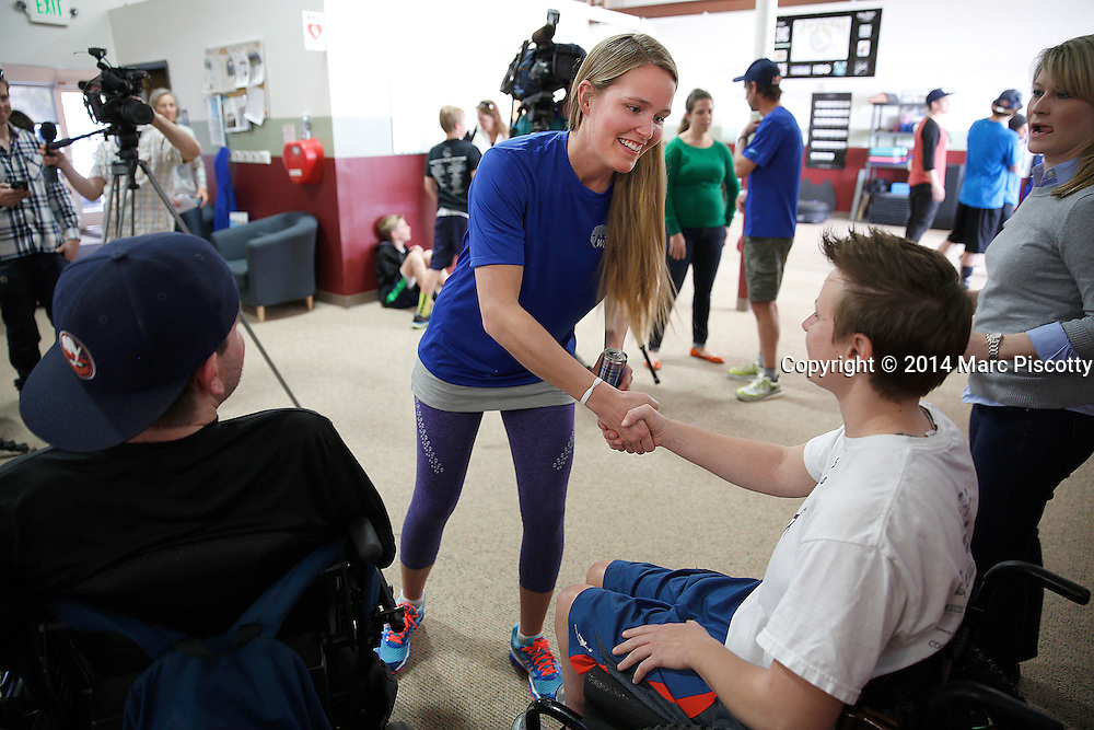 SHOT 3/17/14 2:16:21 PM - Grete Eliassen shakes hands with clients after speaking at a press conference and before working out with clients at the SCI Recovery Project in Denver, Co. on March 17, 2014. The Red Bull sponsored athletes were raising awareness of the 3 million people living with spinal cord injury and encouraging locals to register for the Wings for Life World Run on May 4 this year. Denver will be one of three US cities hosting this unique, simultaneous global endurance event that features a moving finish line and no set distance. (Photo by Marc Piscotty / © 2014)