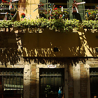 Italian building with balcony and flowers in Venice