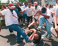 Protesters at a KKK Rally in Saginaw, Michigan attack a Klan supporter who was in the crowd. (Alan Lessig/The Detroit News)