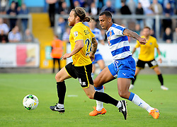 Stuart Sinclair of Bristol Rovers is challenged by Readings's Anton Ferdinand - Mandatory by-line: Neil Brookman/JMP - 21/07/2015 - SPORT - FOOTBALL - Bristol,England - Memorial Stadium - Bristol Rovers v Reading - Pre-Season Friendly