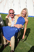 Andrew Neil and Dr. Lisa Hendrickson ( larking around) , Cartier International Polo. Guards Polo Club. Windsor Great Park. 29 July 2007.  -DO NOT ARCHIVE-© Copyright Photograph by Dafydd Jones. 248 Clapham Rd. London SW9 0PZ. Tel 0207 820 0771. www.dafjones.com.