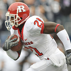 Oct 31, 2009; East Hartford, CT, USA; Rutgers cornerback Devin Mccourty (21) runs back the opening kickoff for a touchdown during first half Big East NCAA football action between Rutgers and Connecticut at Rentschler Field