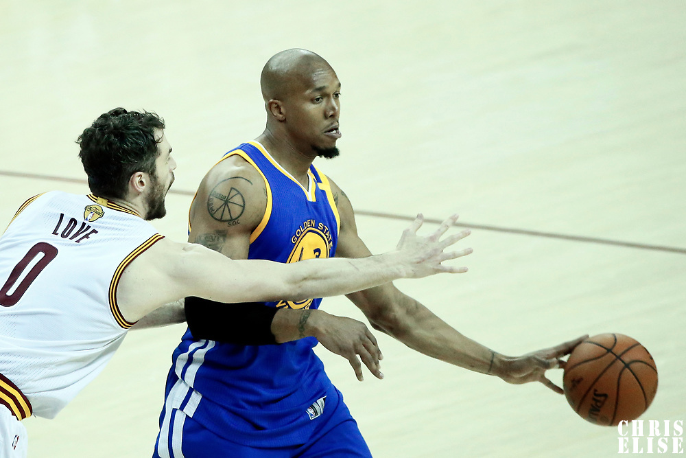 09 June 2017: Golden State Warriors forward David West (3) passes the ball past Cleveland Cavaliers forward Kevin Love (0) during the Cleveland Cavaliers 137-11 victory over the Golden State Warriors, in game 4 of the 2017 NBA Finals, at  the Quicken Loans Arena, Cleveland, Ohio, USA.