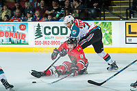 KELOWNA, CANADA - APRIL 7: Devante Stephens #21 of the Kelowna Rockets checks Cody Glass #8 of the Portland Winterhawks on April 7, 2017 at Prospera Place in Kelowna, British Columbia, Canada.  (Photo by Marissa Baecker/Shoot the Breeze)  *** Local Caption ***
