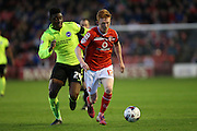 Walsall midfielder, Reece Flanagan gets away from Brighton central midfielder, Rohan Ince during the Capital One Cup match between Walsall and Brighton and Hove Albion at the Banks's Stadium, Walsall, England on 25 August 2015.