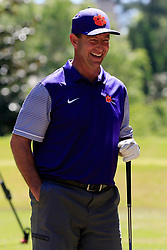 Dabo Swinney reacts to pranking Dan Mullen with an exploding golf ball during the Chick-fil-A Peach Bowl Challenge at the Oconee Golf Course at Reynolds Plantation, Sunday, May 1, 2018, in Greensboro, Georgia. (Paul Abell via Abell Images for Chick-fil-A Peach Bowl Challenge)