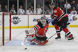 Mar 23; Newark, NJ, USA; New Jersey Devils goalie Martin Brodeur (30) makes a save during the first period of their game against the Toronto Maple Leafs at the Prudential Center.