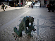 Statue of the shoeblack at Rua da Vitória, downtown Lisbon. This photograph is part of a body of work about Lisbon, feelings, affections and loneliness. Is about a city depressed by the crisis, but even so, tolerant and cosmopolitan. This part of Lisbon, the old town near the river Tejo (Tagus), with his deep character, where local people meets foreigners and alternative ways of life mixes with shamefaced poverty, is sublime by its peculiar light.