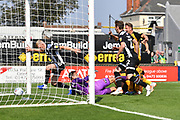 Grimsby Town's Elliott Whitehouse(10) scores own goal to go 0-1 during the EFL Sky Bet League 2 match between Grimsby Town FC and Port Vale at Blundell Park, Grimsby, United Kingdom on 24 August 2019.