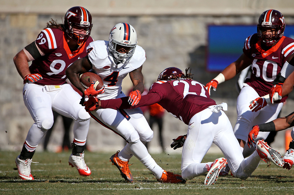 Nov 26, 2016; Blacksburg, VA, USA;  Virginia Cavaliers running back Taquan Mizzell (4) runs the ball against Virginia Tech Hokies linebacker Terrell Edmunds (22) during the first quarter at Lane Stadium. Mandatory Credit: Peter Casey-USA TODAY Sports