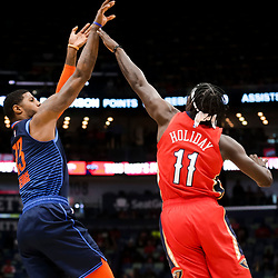 Feb 14, 2019; New Orleans, LA, USA; Oklahoma City Thunder forward Paul George (13) shoots over New Orleans Pelicans guard Jrue Holiday (11) during the first quarter at the Smoothie King Center. Mandatory Credit: Derick E. Hingle-USA TODAY Sports