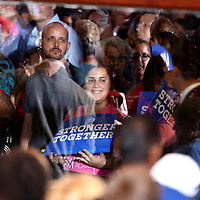 Overflow supporters of Democratic Presidential nominee Hillary Clinton are seen through an exterior window at the Sanford Civic Center in Sanford, Florida USA on12 Feb 2016.