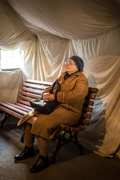 DNIPROPETROVSK, UKRAINE - OCTOBER 11: A woman waits in a tent for the opening of a center to help people displaced by fighting in Ukraine's East on October 11, 2014 in Dnipropetrovsk, Ukraine. The United Nations has registered more than 360,000 people who have been forced to leave their homes due to fighting in the East, though the true number is believed to be much higher. (Photo by Brendan Hoffman/Getty Images) *** Local Caption ***