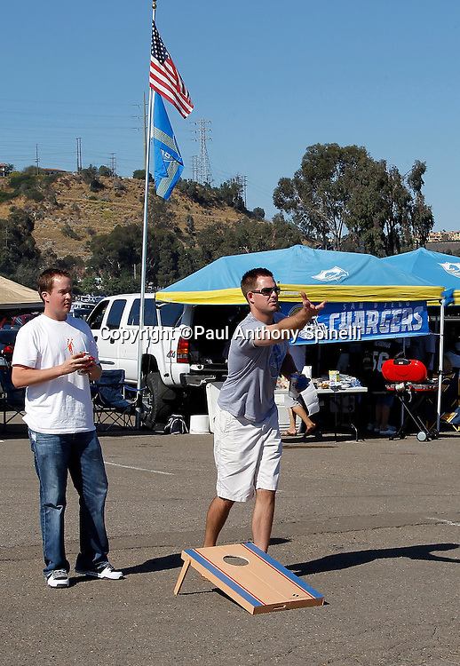 San Diego Chargers fans play bean bag horseshoes as they tailgate before a NFL week 2 preseason football game against the Dallas Cowboys on Saturday, August 21, 2010 in San Diego, California. The Cowboys won the game 16-14. (©Paul Anthony Spinelli)