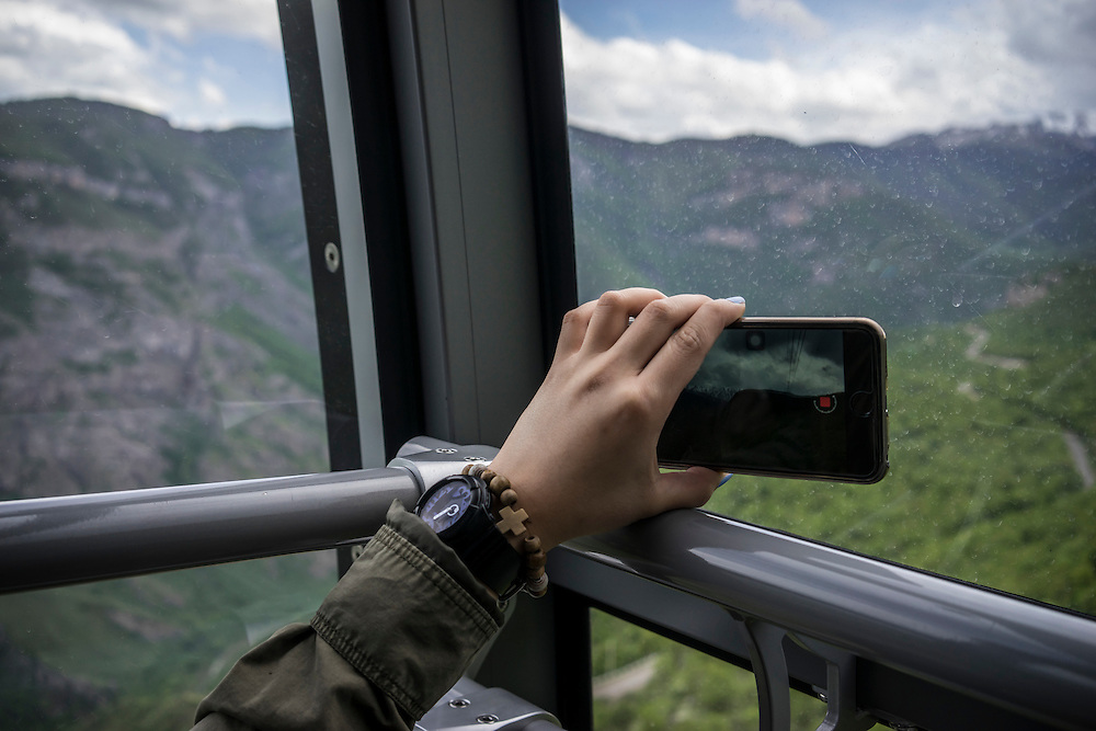 A tourist makes a video with her cell phone from the Wings of Tatev aerial tramway on Saturday, May 7, 2016 in Halidzor, Armenia.