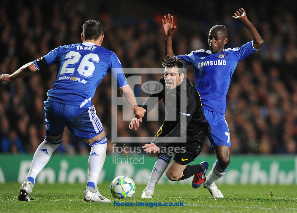Picture by Andrew Timms/Focus Images Ltd. 07917 236526.18/04/12.John Terry & Ramires of Chelsea and Lionel Messi of Barcelona during the UEFA Champions League semi final first leg match at Stamford Bridge stadium, London.
