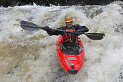 061210-Morrison, COLORADO-wildwaterart-Kayaker Kedron Holmers, of Golden, maneuvers through the white water rapids Saturday, June 12, 2010 on Bear Creek. Heavy rain fall at higher elevations has caused the normally peaceful creek to swell. .Photo By Matthew Jonas/Evergreen Newspapers/Photo Editor