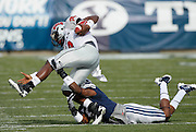 UNLV quarterback Omar Clayton, top, is tackled by BYU cornerback Brandon Bradley, bottom, during the first half of an NCAA college football game at LaVell Edwards Stadium, Saturday, Nov. 6, 2010, in Provo, Utah.  BYU defeated UNLV 55-7. (AP Photo/Colin E. Braley)