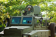 """Sept 26, 2009 -- PATTANI, THAILAND: A Thai army armored car patrols the main highway between the provincial capitols of Pattani and Narathiwat Saturday, Sept. 26. Thailand's three southern most provinces; Yala, Pattani and Narathiwat are often called """"restive"""" and a decades long Muslim insurgency has gained traction recently. Nearly 4,000 people have been killed since 2004. The three southern provinces are under emergency control and there are more than 60,000 Thai military, police and paramilitary militia forces trying to keep the peace battling insurgents who favor car bombs and assassination.   Photo by Jack Kurtz / ZUMA Press"""