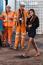 "© licensed to London News Pictures. London, UK 14/12/2013. A ""Mad Friday"" reveller going past Crossrail workers in central, London whilst enjoying the last Friday night out before Christmas, which is also the busiest night of the year for emergency services. Photo credit: Tolga Akmen/LNP"