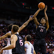 09 March 2018: San Diego State men's basketball takes on Nevada in the quarterfinal round of the Mountain West Conference Tournament. San Diego State Aztecs forward Malik Pope (21) takes a jump shot in the key during the first half. The Aztecs cruise past the Wolfpack 90-73 to move on to the Championship game tomorrow afternoon at 3pm.<br /> More game action at www.sdsuaztecphotos.com