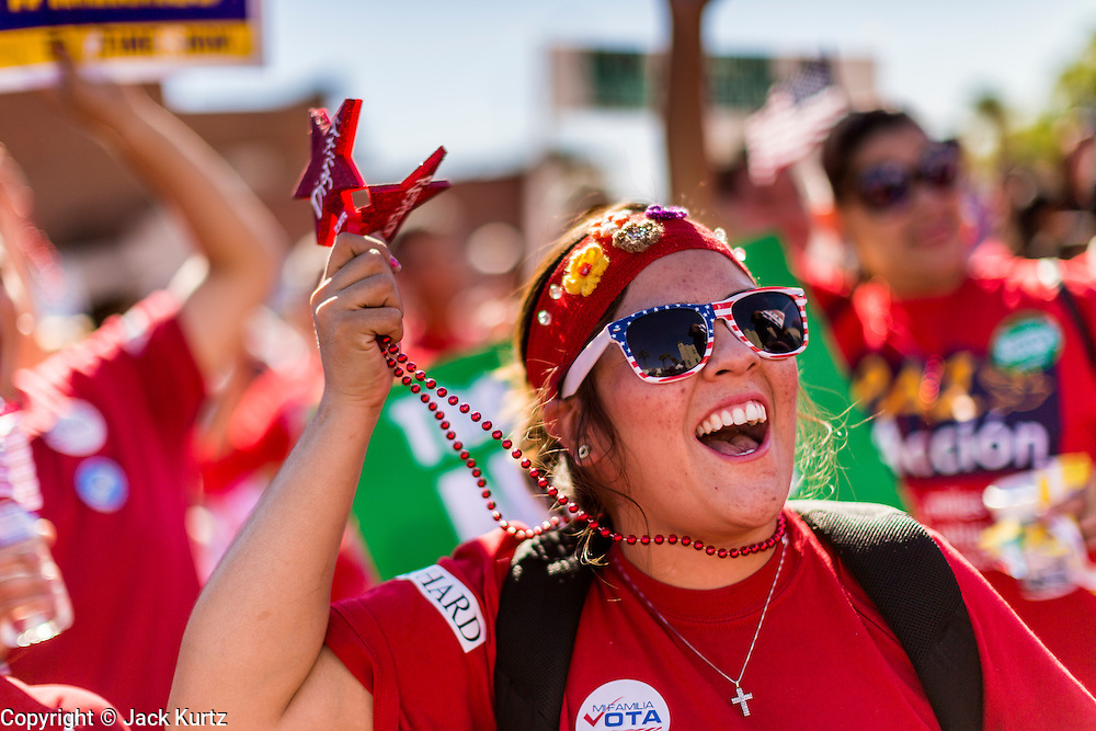 05 OCTOBER 2013 - PHOENIX, ARIZONA:   A woman cheers speakers at an immigration rally in Phoenix. More than 1,000 people marched through downtown Phoenix Saturday to demonstrate for the DREAM Act and immigration reform. It was a part of the National Day of Dignity and Respect organized by the Action Network.    PHOTO BY JACK KURTZ