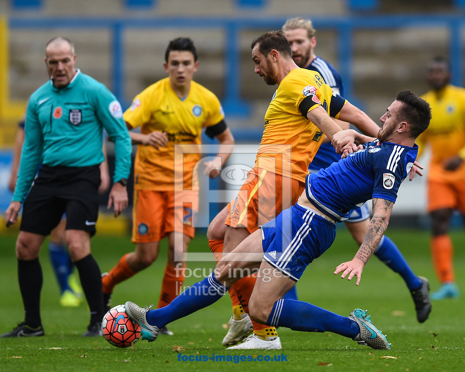Kiel O&rsquo;Brien of FC Halifax and Paul Hayes of Wycombe Wanderers during the FA Cup match at Shay Stadium, Halifax<br /> Picture by Richard Land/Focus Images Ltd +44 7713 507003<br /> 08/11/2015