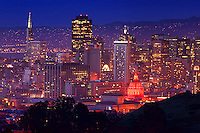 Downtown San Francisco featuring City Hall (illuminated in red light)