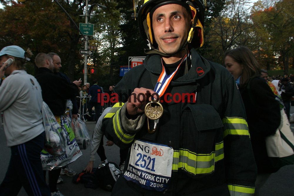 11/5/2006. New York, NY. Murat Turk of Pocantico Hills fire department shows his medal. Turk broke the record in his category, running with 45 pounds fire equipment and finishing with a time of 4:45:10.  More than 37,000 athletes gathered to compete  at the 26.2 mile New York Marathon. The run crossed the five burroughs of New York including Queens, Bronx, Brooklyn and Manhattan finishing in Central Park. IPAPHOTO.COM