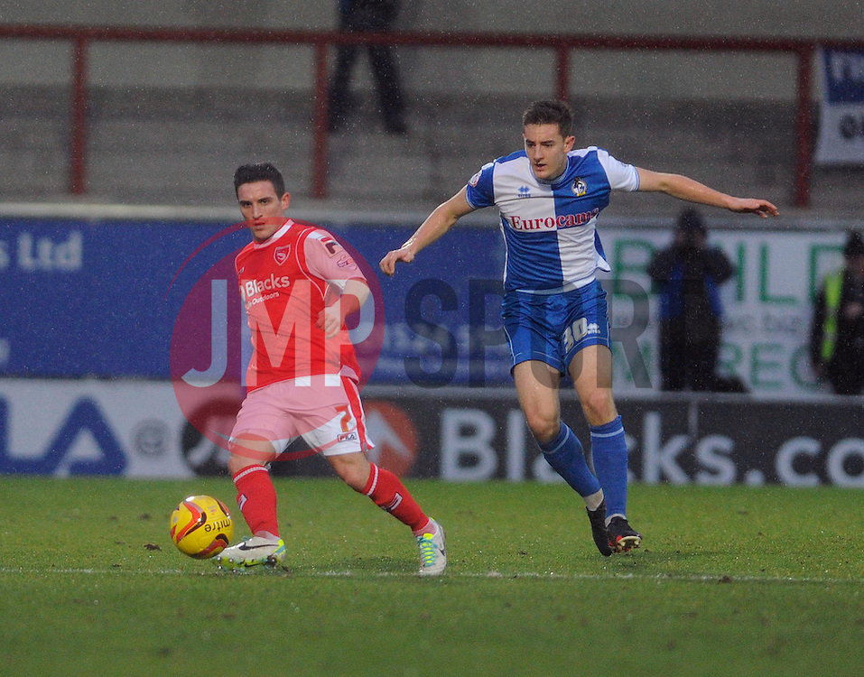 Bristol Rovers' Tom Lockyer chases down Morecambe's Jack Redshaw - Photo mandatory by-line: Dougie Allward/JMP - Tel: Mobile: 07966 386802 14/12/2013 - SPORT - Football - Morecombe - Globe Arena - Morecombe v Bristol Rovers - Sky Bet League Two