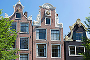 Traditional ornate canalside gabled houses - Dutch gables on Brouwersgracht in Amsterdam, Holland