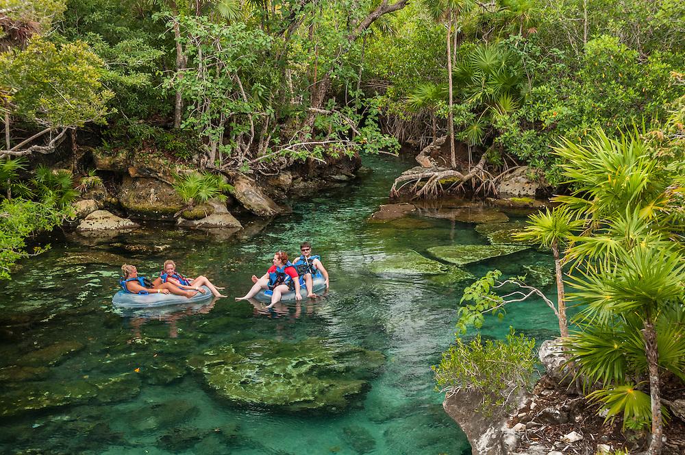 Rafting in the lagoon at Xel-Ha nature park, Riviera Maya, Mexico.