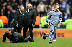 A pitch invader runs across the pitch during the Sky Bet Championship match at Molineux, Wolverhampton.