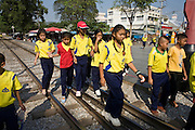 "20 FEBRUARY 2008 -- KANCHANABURI, THAILAND: Thai school children walk over the ""Bridge over the River Kwai"" in Kanchanaburi, Thailand. The infamous bridge and the ""Death Railway"" that connected Thailand and Burma were built by Japanese military forces using prisoner of war and slave labor during World War II. More than 200,000 POWs and laborers were used to build the railway, about half of them died during the construction.  Photo by Jack Kurtz"