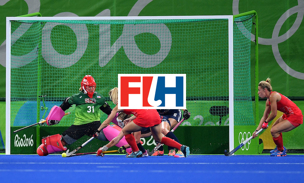 Britain's Sophie Bray (C) attempts to score during the women's field hockey Britain vs the USA match of the Rio 2016 Olympics Games at the Olympic Hockey Centre in Rio de Janeiro on August, 13 2016. / AFP / MANAN VATSYAYANA        (Photo credit should read MANAN VATSYAYANA/AFP/Getty Images)