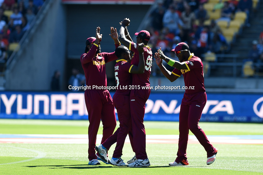 West Indies players celebrate the wicket of Brendon McCullum during the ICC Cricket World Cup Quaterfinal match between New Zealand and West Indies at Westpac Stadium in Wellington, New Zealand. Saturday 21  March 2015. Copyright Photo: Raghavan Venugopal / www.photosport.co.nz