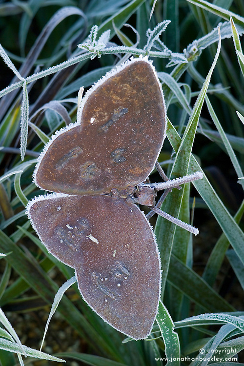 Metal butterfly sculpture with frost