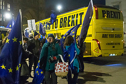 """A bus emblazoned with """"Bollox to Brexit"""" leaves Steve Bray's ongoing pro-remain protest at Old Palace Yard outside Parliament. Westminster, London, December 20 2018."""