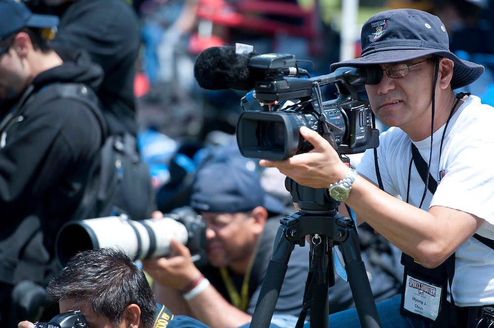 4/29/12 --- SPORTS SHOOTER ACADEMY --- Sports Shooter Academy multimedia guru Myung J. Chun during a track & field meet. Myung is on the staff of the Los Angeles Times. Photo by Christy Radecic, Sports Shooter Academy Behind the Scenes with the cast and crew of Sports Shooter Academy.