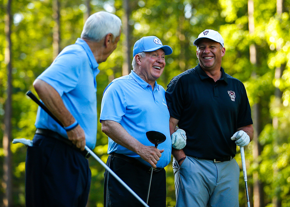 North Carolina head basketball coach Roy Williams, North Carolina head football coach Mack Brown and North Carolina State head football coach Dave Doeren have a laugh during the Chick-fil-A Peach Bowl Challenge at the Ritz Carlton Reynolds, Lake Oconee, on Monday, April 30, 2019, in Greensboro, GA. (Paul Abell via Abell Images for Chick-fil-A Peach Bowl Challenge)