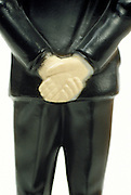 Rear view male doll with hands crossed