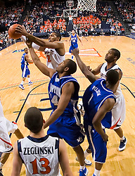 Virginia forward Mike Scott (32) grabs a rebound against Hampton.  The Virginia Cavaliers defeated the Hampton Pirates 74-48 at the John Paul Jones Arena on the Grounds of the University of Virginia in Charlottesville, VA on December 23, 2008. (Special to the Daily Progress / Jason O. Watson)