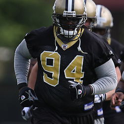 New Orleans Saints defensive end Charles Grant #94 indicted on Tuesday, May 20, 2008 on a charge of involuntary manslaughter that stems from a February shooting death in a Georgia nightclub was on the field participating with teammates during the Saints organized team activities held at the team's training facility in Metairie, LA.