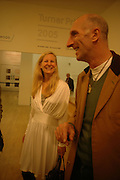 ALLANAH WESTON AND RICHARD STRANGE. Private view for the Turner prize  2005.  Tate. Britain. 17 October 2005. ONE TIME USE ONLY - DO NOT ARCHIVE © Copyright Photograph by Dafydd Jones 66 Stockwell Park Rd. London SW9 0DA Tel 020 7733 0108 www.dafjones.com