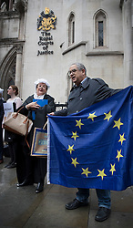 © Licensed to London News Pictures. 13/10/2016. London, UK. Campaigners stand out side the High Court as a legal challenge is launched, after the EU referendum result, to force the government to seek Parliamentary approval before Brexit negotiations begin. Photo credit: Peter Macdiarmid/LNP