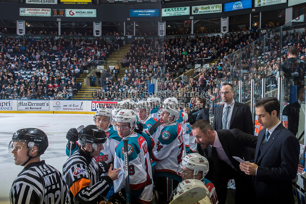 KELOWNA, CANADA - MARCH 24: Kelowna Rockets' head coach Jason Smith stands on the bench and speaks to referee Jeff Ingram against the Kamloops Blazers on March 24, 2017 at Prospera Place in Kelowna, British Columbia, Canada.  (Photo by Marissa Baecker/Shoot the Breeze)  *** Local Caption ***